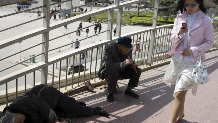Nemáte drobné? Čínski žobráci prešli na bezhotovostné dary