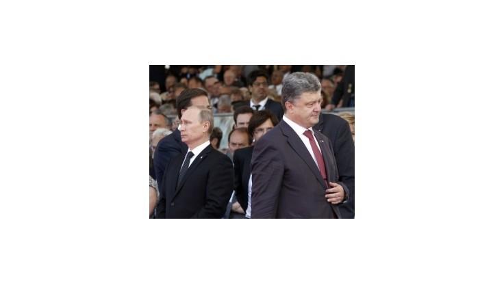 Putin a Porošenko diskutovali o urovnaní krízy na Ukrajine